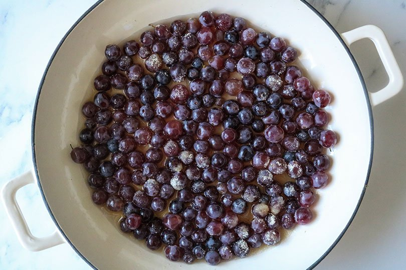 melting grapes with skillet on stovetop
