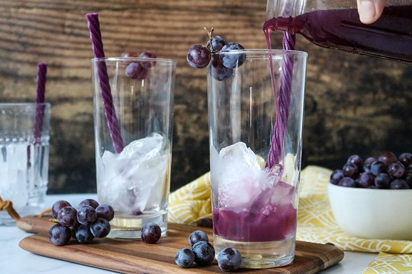 filling glasses with grape Juice