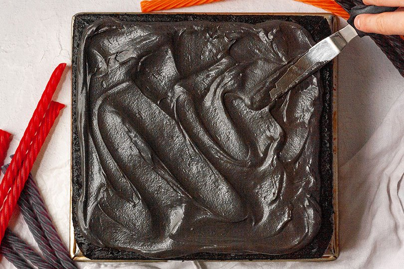 frosting a chocolate sheet cake