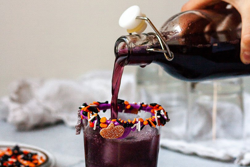 pouring halloween cocktail